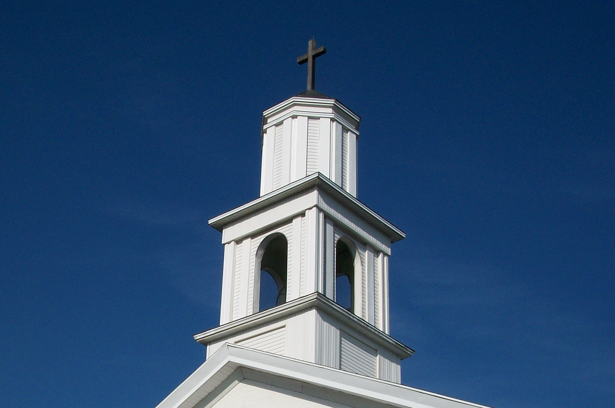 Steeple against blue sky